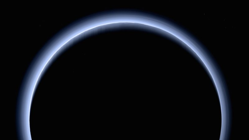 Black circle with edge of light blue fading to dark blue against black space.