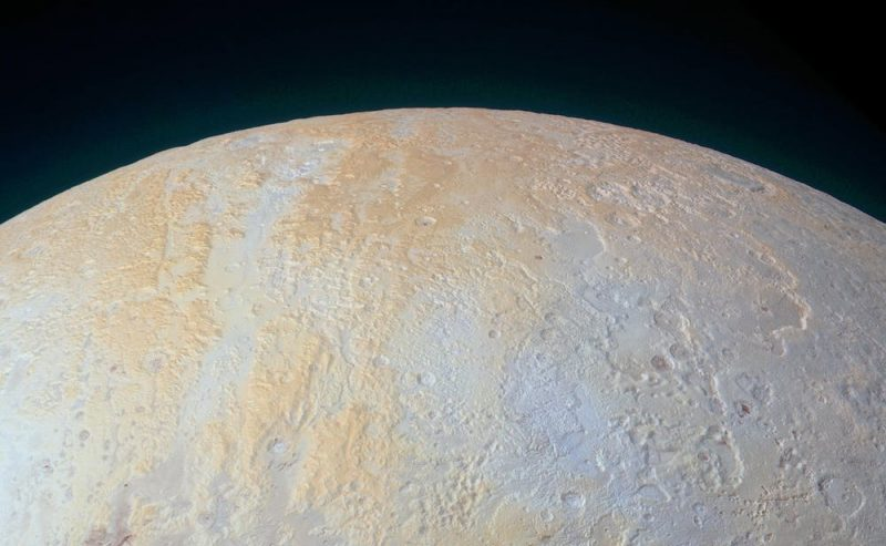 Part of planet with long light orange features against light blue surface.