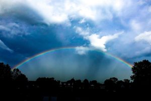 Inside the curve of a rainbow, you can see dark spokes, like the spokes of a wheel.