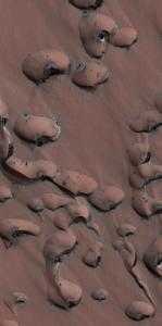 Spotted sand dunes on Mars.