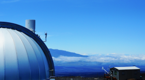 White observatory dome against blue sky background