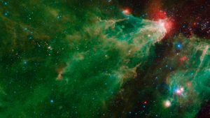 A large green and orange nebula with stars clusters.
