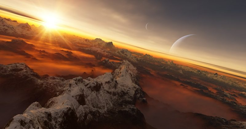 Mountains with fog in valleys, sun peeking over horizon, two crescent moons in the sky.