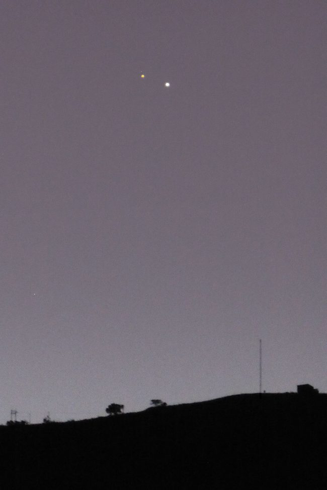 Two bright dots close together against slate-blue sky. Mars is distinctly reddish.