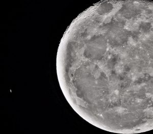 A telescopic view of a tiny-looking Saturn, next to a telescopic view of a huge moon.