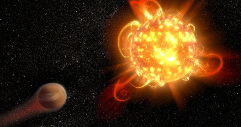 Bright flaming yellow-orange ball on black background. Planet with atmosphere being swept away.
