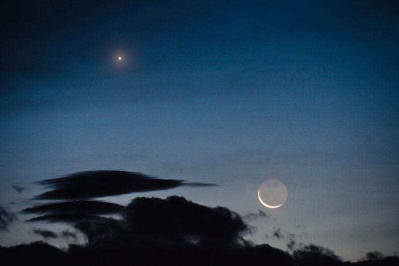 Bright Venus in the twilight with an exceedingly thin and fragile waning moon below it.