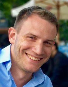 Headshot of smiling Bjorn Benneke.
