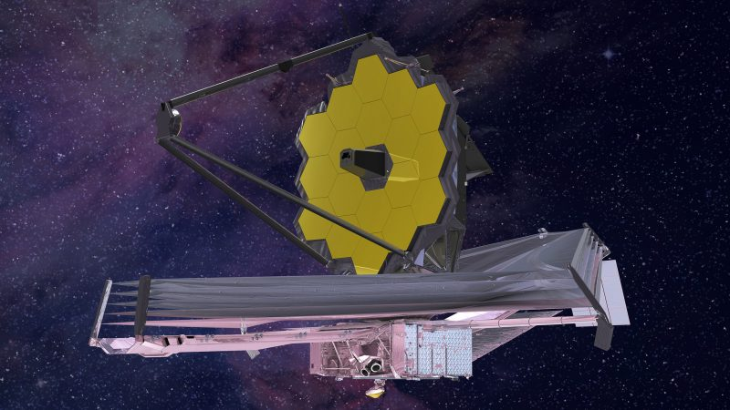 Floating in space, a spacecraft with a large curved mirror made of gold hexagons.