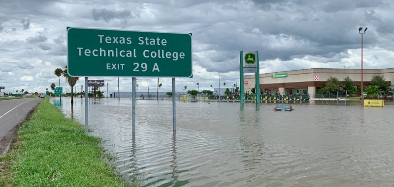 View along highway completely underwater with large Exit 29 A sign.