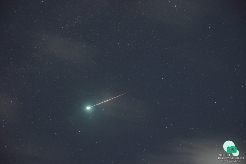 Bright meteor streak with an explosive looking green 'pop' on one end.