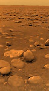 Barren orange brown rocky ground.