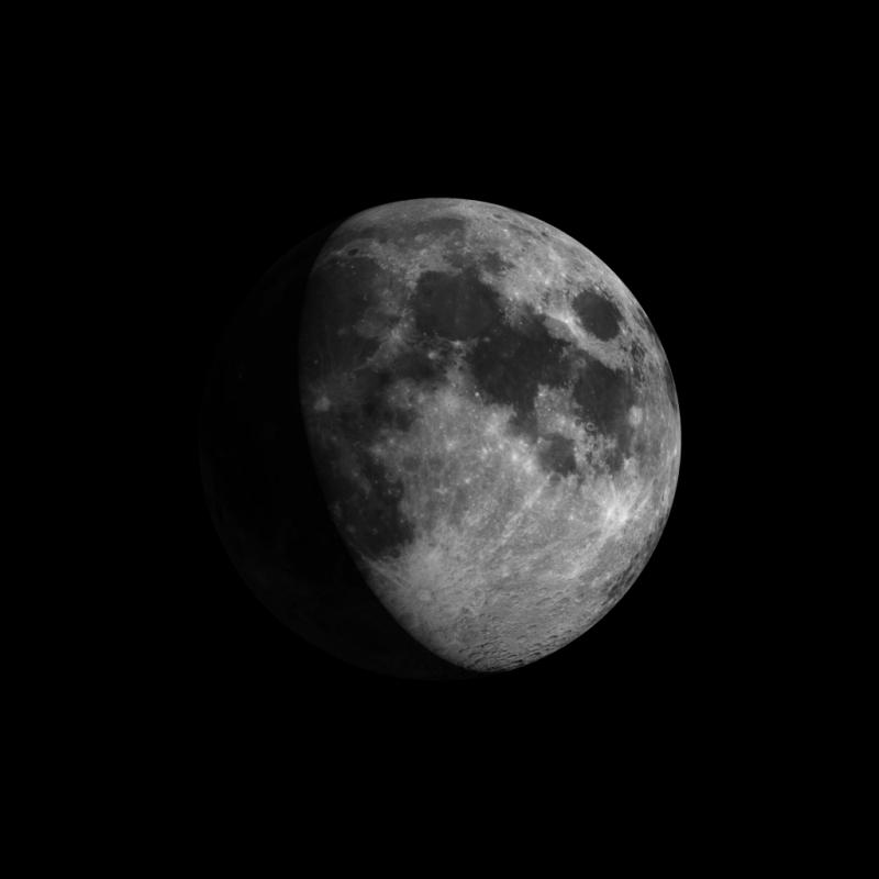 Gibbous moon with large, roundish, irregular dark patches on it.