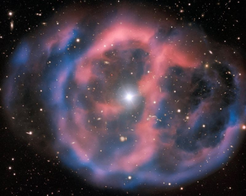 Transparent pink and blue blob with black starry sky visible and one brilliant star in the middle.