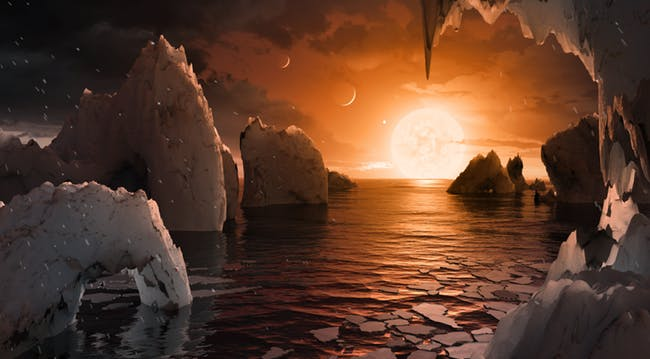Alien sunset with crescent planets in sky over sea inlet bordered with cliffs.