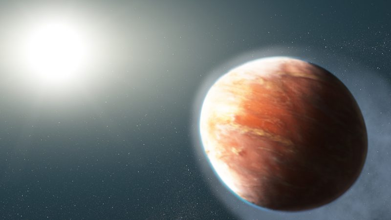 Close bright sunlike star to left, oblong football-shaped exoplanet to right.