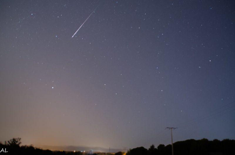 Very bright Perseid meteor streaking the sky at dawn.
