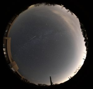 Automatic camera view of the Tucson skyline and a bright Perseid meteor.