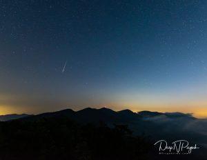 Meteor over a mountain skyline.