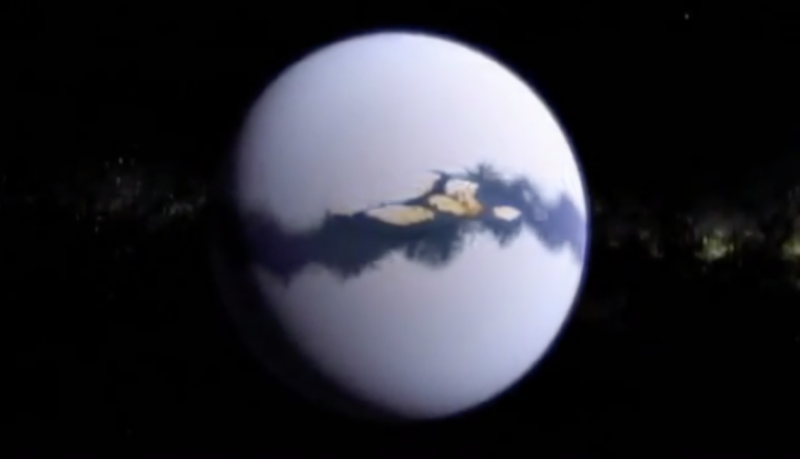 White planet with wide blue strip of water at equator with tan land areas in it.