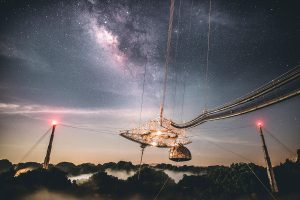Astronomical equipment in the foreground, the Milky Way in the background.