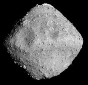 A blocky asteroid, shaped somewhat like a spinning top.