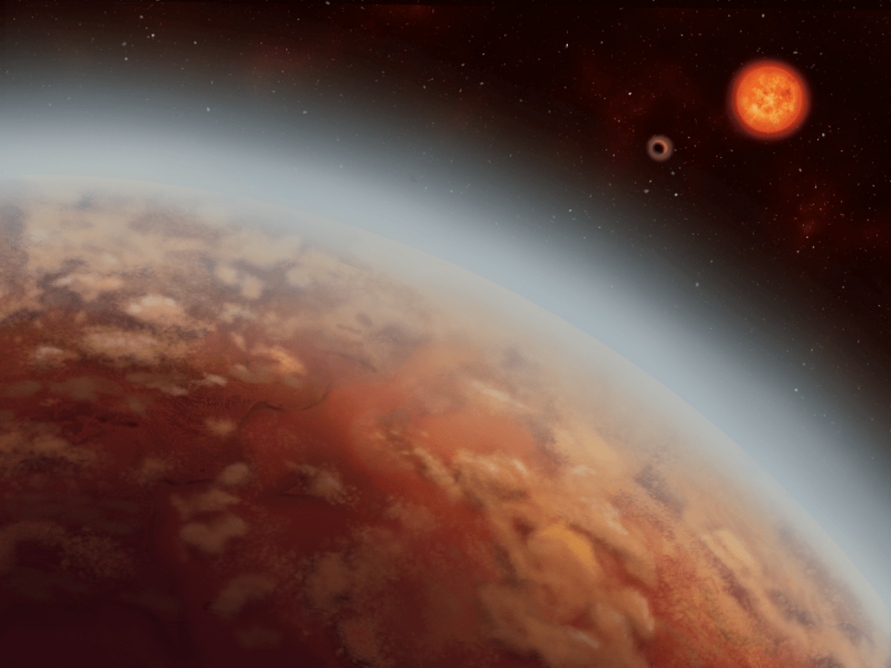 Patchy tan-orange planet with atmosphere; roiling reddish star in the distance.