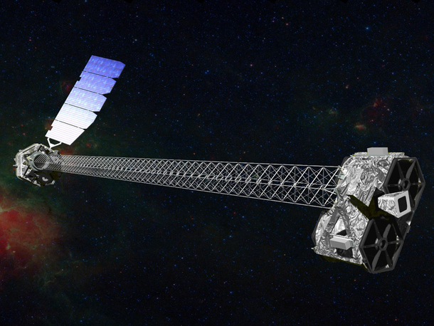 Spacecraft: long narrow metal grid with machinery at each end and solar panel wing.