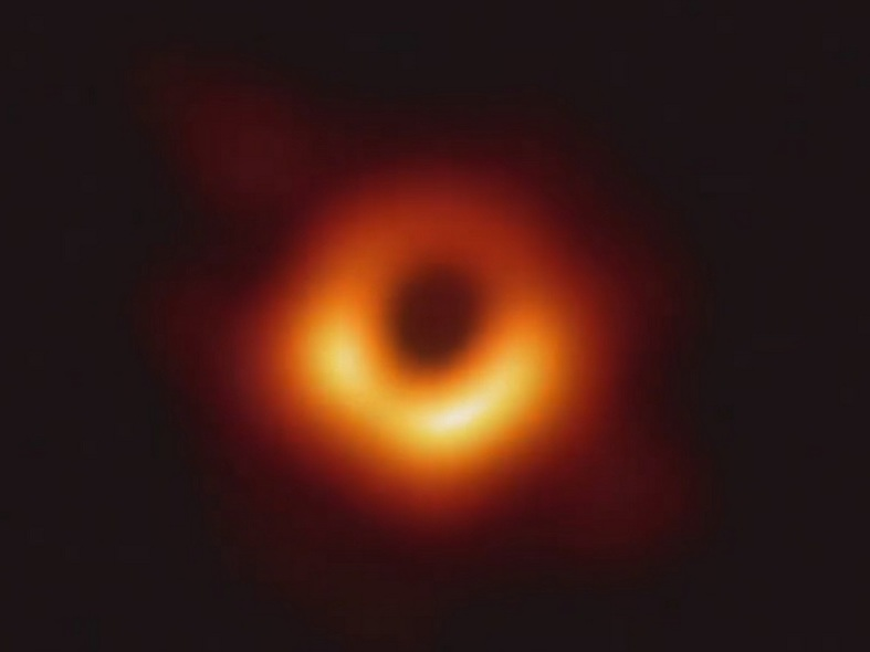 Glowing orange and yellow ring around a black central circular area.