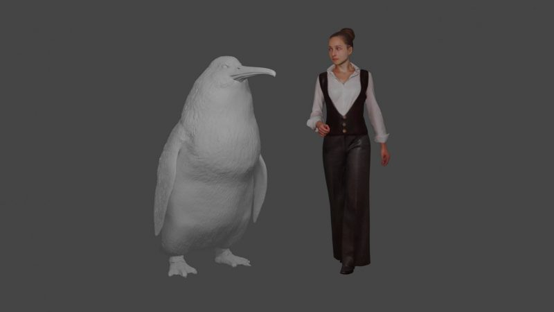 Model of a big white penguin next to photo of a woman.