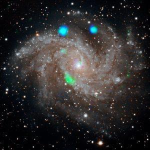 Spiral galaxy with apparent green blob.