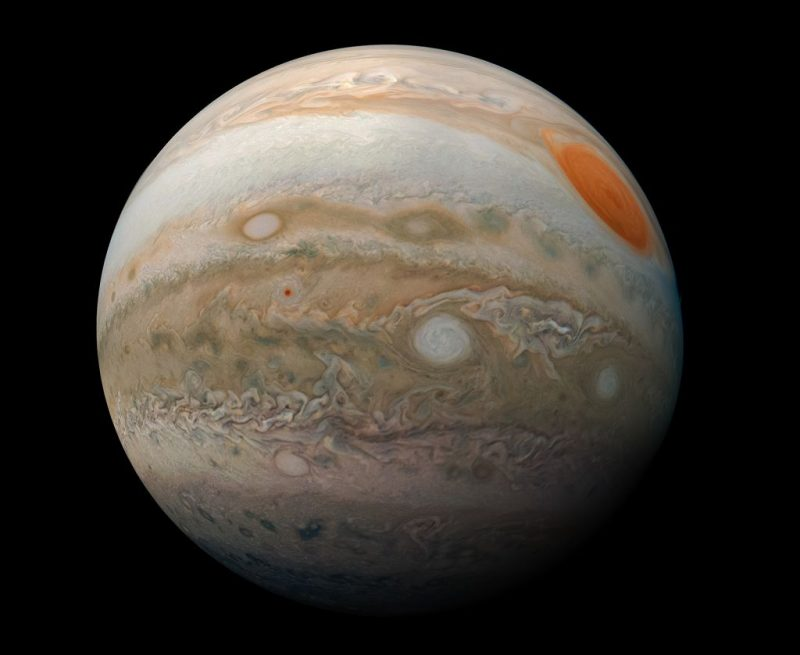Jupiter, with bands and red spot, seen from spacecraft Juno.