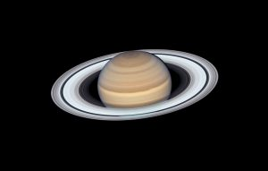 Saturn, with rings wide open, and a lot of details on the body of the planet.