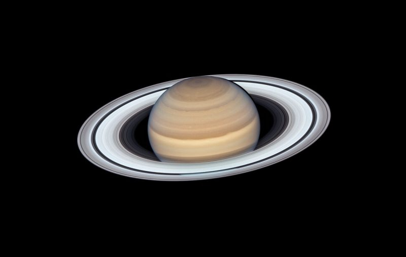 Saturn, with wide bright rings, and a lot of details on the body of the planet.