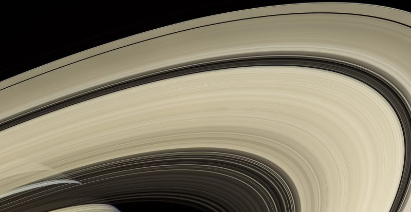 A wide arc of Saturn's rings, showing the gap known as Cassini's Division and other gaps and shadings.