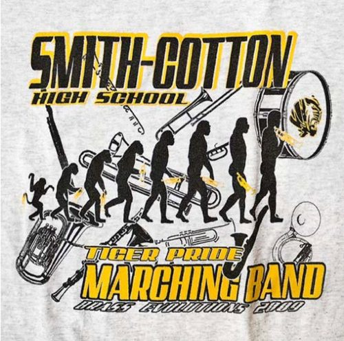 Logo on a t-shirt. Illustration of band instruments and monkey-to-man sequence.