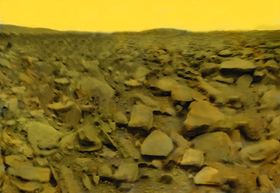 Image of a spaceship on a lifeless, dry, rocky planetary surface, under a yellow sky.