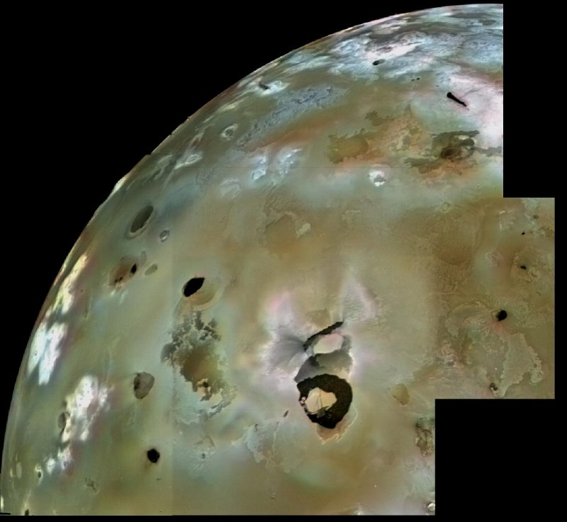 A portion of the surface of Io, appearing pale green with light and dark mottling.