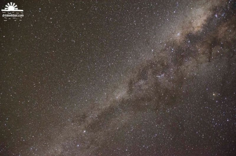 Dense star field with Milky Way with dark rifts clearly visible.