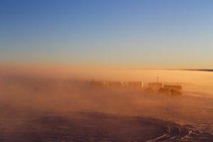 Brown-yellow mist, blue sky.