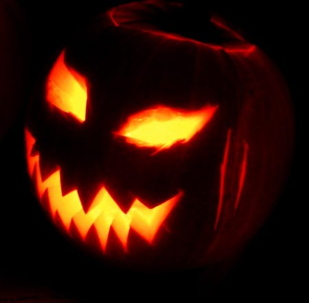 Pumpkin with a scary face and an internal light, likely a candle.