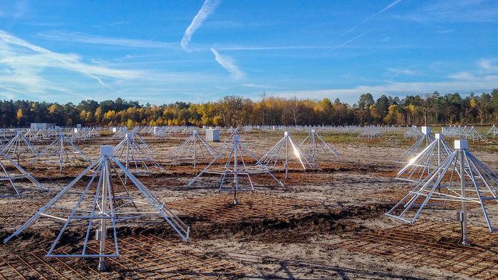 Array of many pyramid-like metal frameworks in a field.