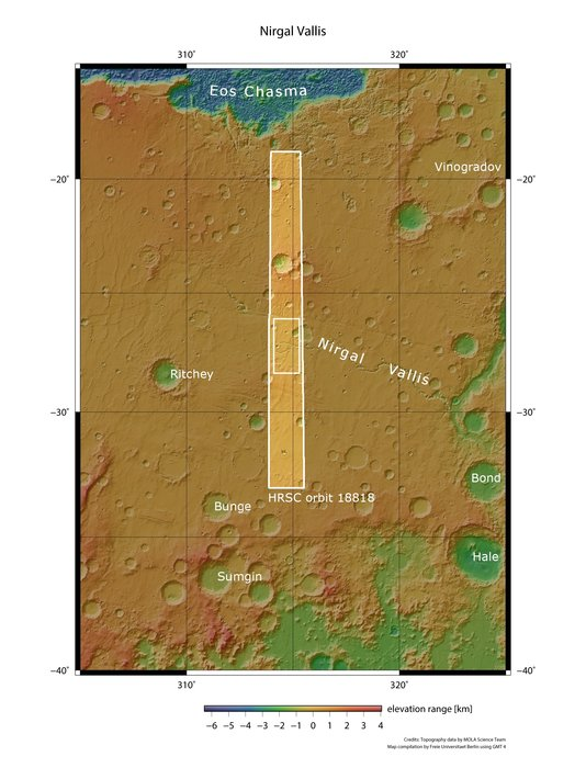 Satellite view of wide section of Mars with lower elevations in green and outlined rectangular area.