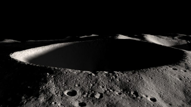 Oblique view of deep crater with shadows on the moon.