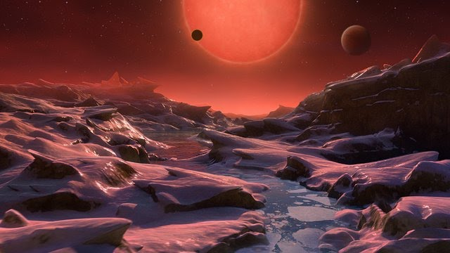 Rocky landscape, stream of water, looming red sun, two other planets visible in the dark red sky.