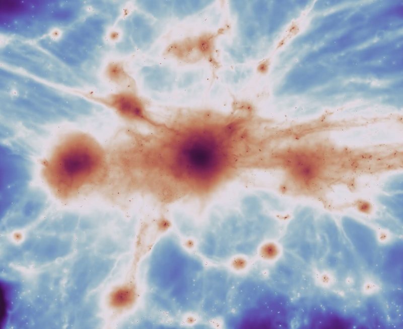 An ink-blot-looking image of long filaments of gas with large nodes along them.