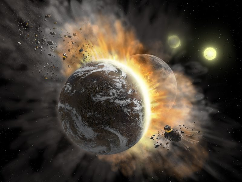 Earthlike planet hitting another with fire and debris exploding from them.