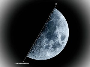 A precisely half-illuminated moon.