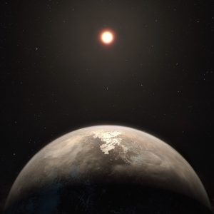 Small rocky exoplanet with its sun in background.