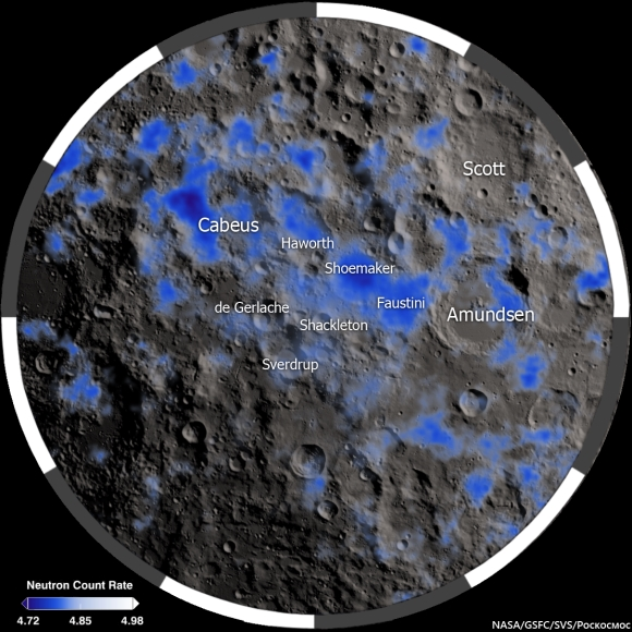 Orbital view of craters on the moon with many blue patches.